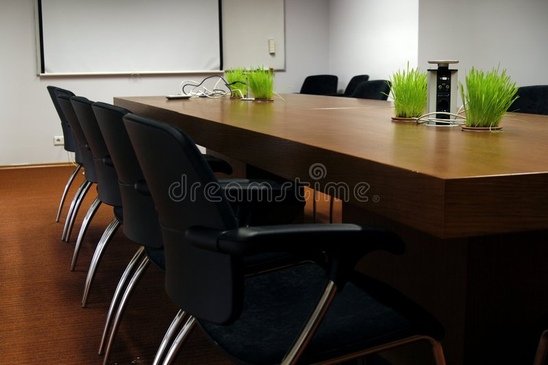 Empty business conference room. Room is modern and has trendy design elements royalty free stock photography