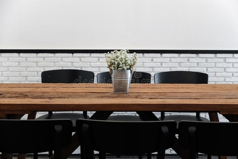 Download Empty Cafe Seating Area With Wooden Table And Chairs In Minimal Stock Photo