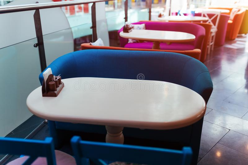 Empty cafe in shopping center. Row of tables with chairs in mall. Modern interior design of restaurant royalty free stock photos