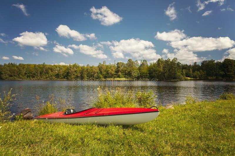 Empty canoe by lake stock photography
