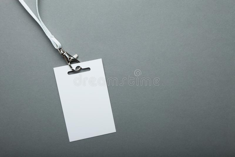 Empty card ID for the event / badge with a belt on a gray background stock images