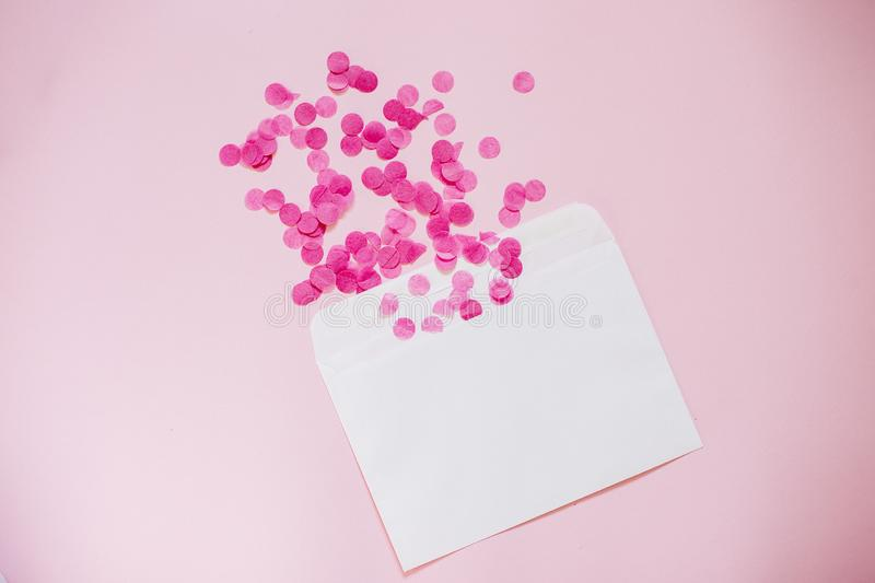 Empty card with Pink paper confetti. Empty card with Pink paper confetti and kraft envelope, holiday concept royalty free stock images