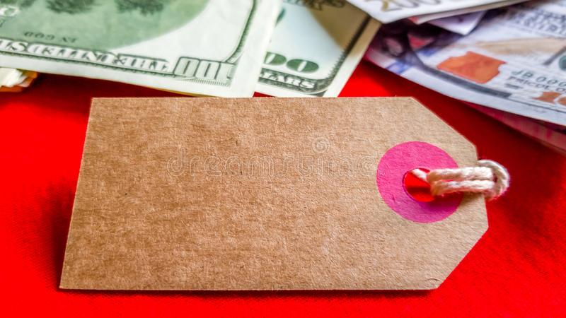 Empty cardboard tag for the inscription Black Friday with American dollars on a red background. Background, holiday concept. Black. Friday - International Day royalty free stock images