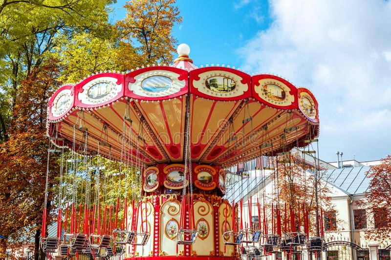 Empty Carousel Merry-Go-Round With Seats Suspended On Chains Wi royalty free stock photo