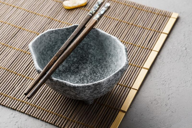 Empty ceramic bowl and chopsticks. Asian lunch table setting. Empty ceramic bowl for soup and chopsticks. Asian lunch table setting stock images