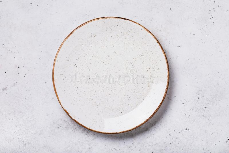 Empty ceramic plate on the table with abstract texture. Food background stock photo