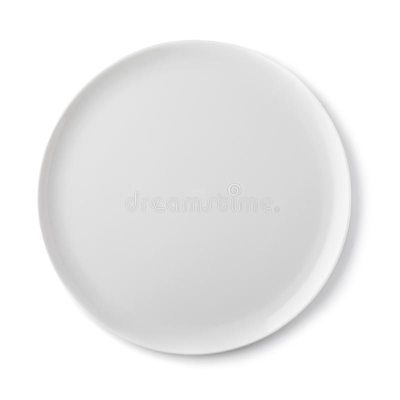 Empty ceramic plate of white color, top view of an isolated stock photo