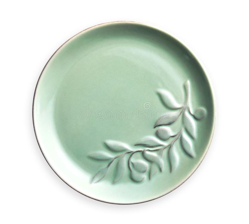 Empty ceramics plates, Green plate with floral pattern, View from above isolated on white background with clipping path royalty free stock image