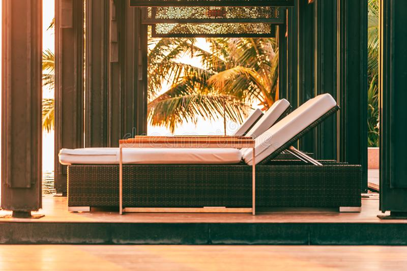 Empty chair around swimming pool in hotel and resort for leisure travel. And vacation stock photography