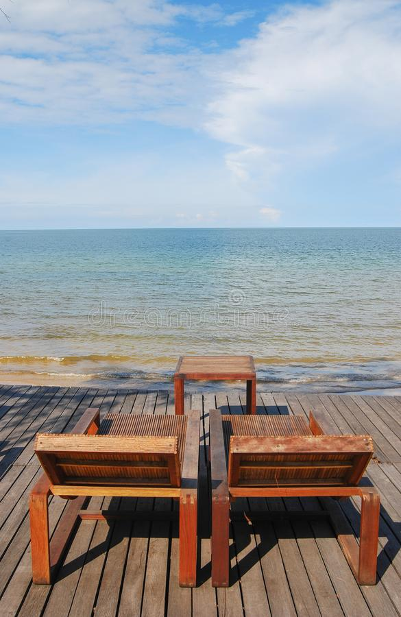 Empty chair on the beach. Empty wood chair on the beach stock image