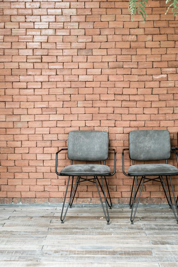 chair with brick wall stock photography