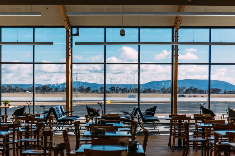Empty chairs at airport terminal royalty free stock photography