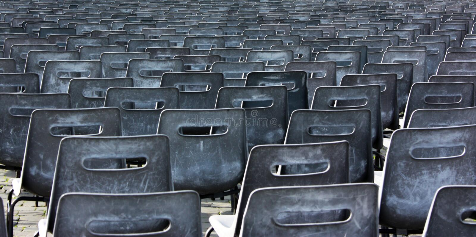 Empty chairs of auditorium. Seats for visitors in the auditorium, empty chairs stock images