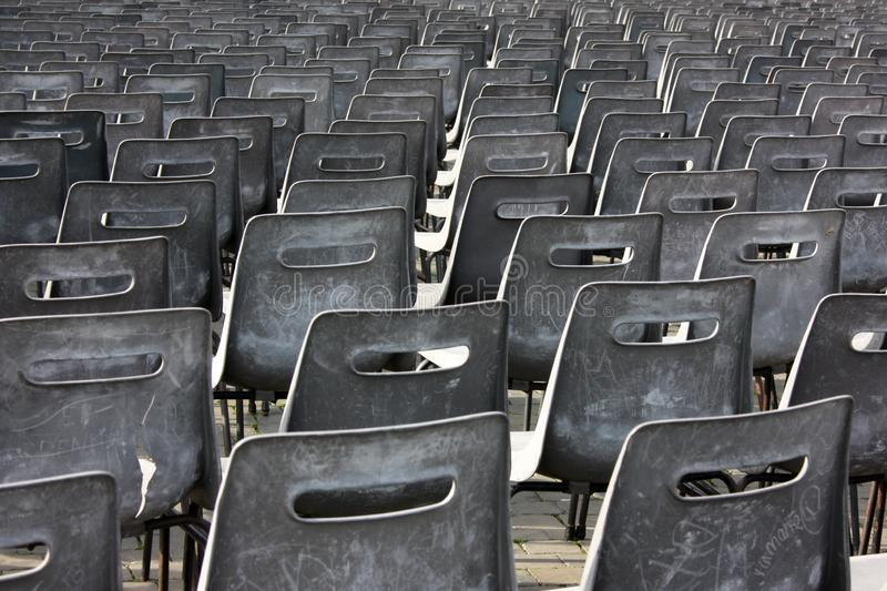 Empty chairs of auditorium. Seats for visitors in the auditorium, empty chairs royalty free stock image