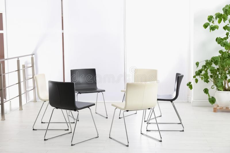 Empty chairs prepared for group psychotherapy session. Indoors royalty free stock image