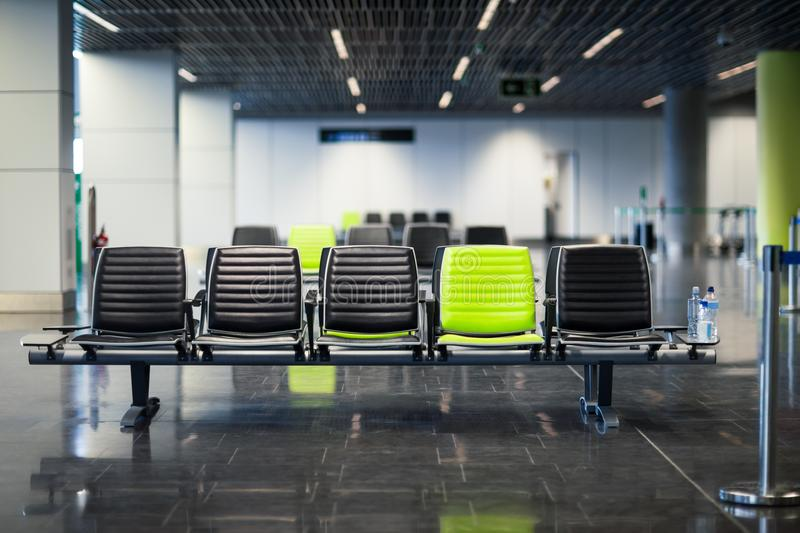 Empty chairs in waiting room at the airport stock photo