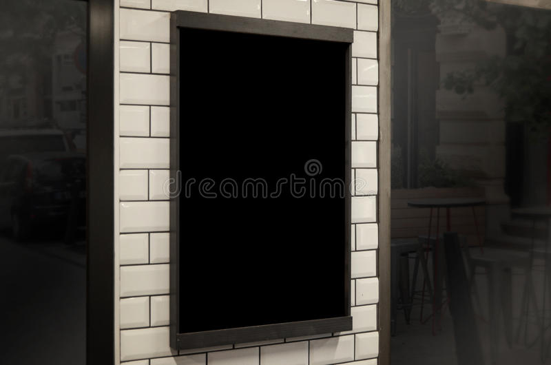 Empty chalkboard in restaurant or coffee shop for logo, identity, branding promotion royalty free stock images