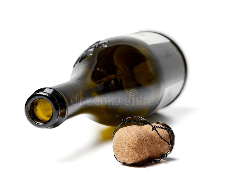 Empty champagne bottle and cork Close-up. White isolated background. royalty free stock photos