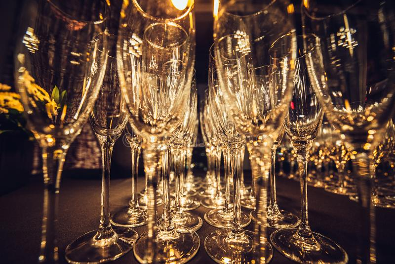 Empty champagne glasses in row on evening event party waiting for the guests. royalty free stock photo