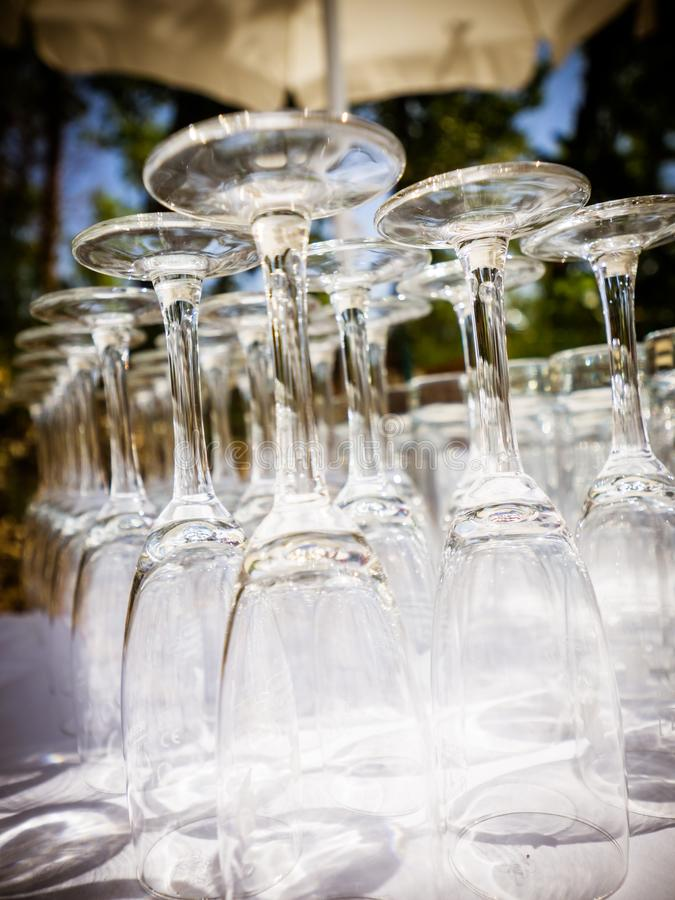 The empty champagne glasses on the table stock photos