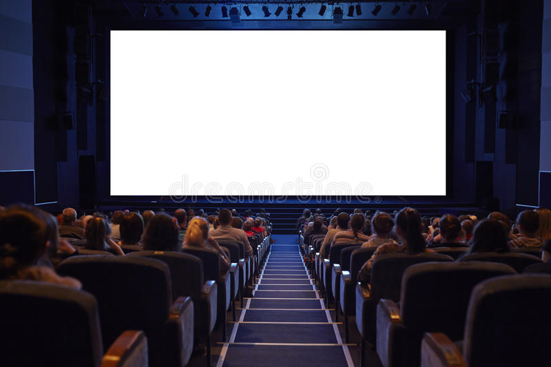 Empty cinema screen with audience. stock image