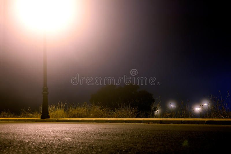 Empty city street at night stock photo