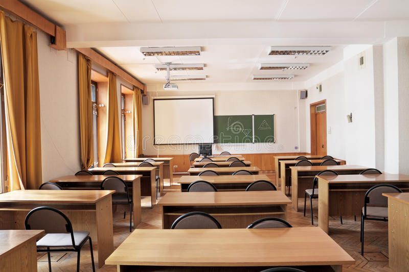Empty classroom. Empty big classroom at school royalty free stock images