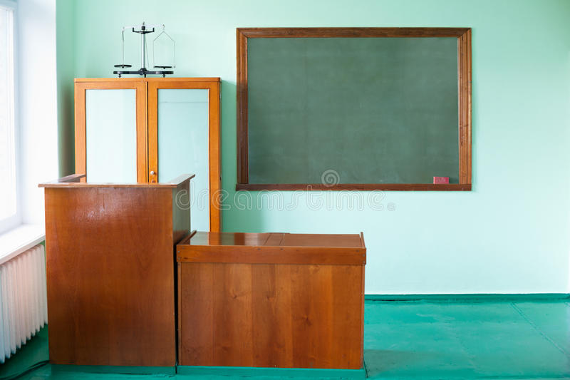 Empty Classroom. Blackboard, chair and table of the teacher stock images