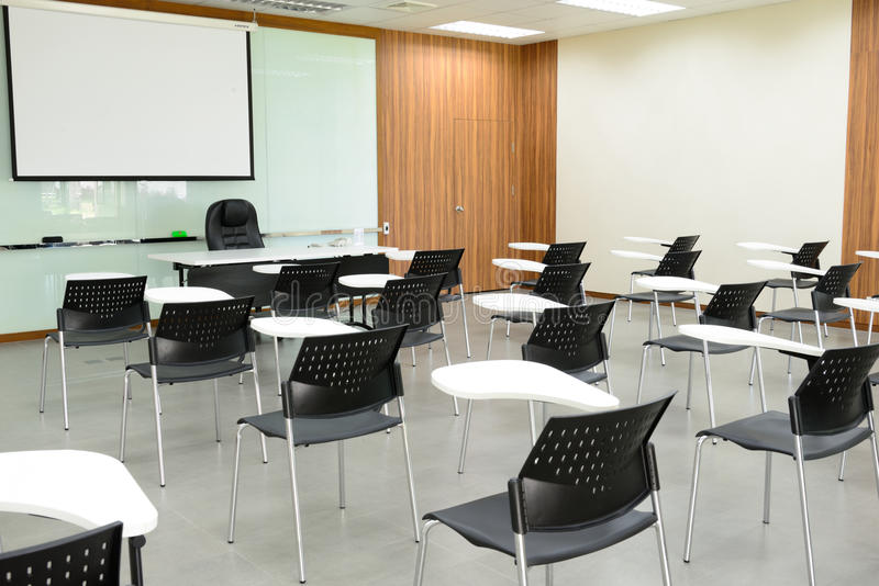 The empty classroom. The empty modern classroom with many chairs royalty free stock photo