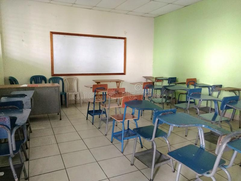 Empty classroom with desks and blackboard. back to school concept royalty free stock images
