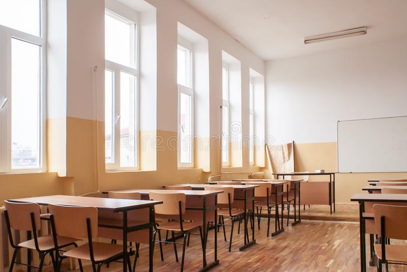 Empty classroom. Interior wooden desks and chairs stock image