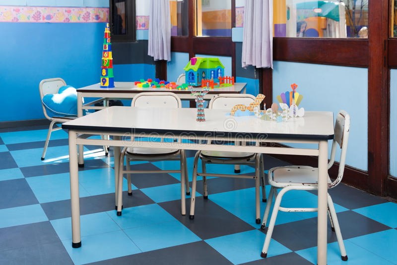 Empty Classroom. Empty preschool classroom with blocks and crafts on table stock images