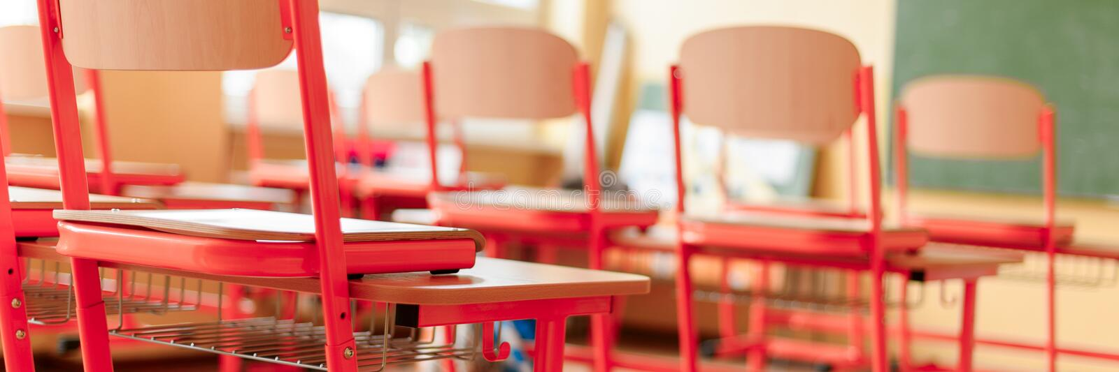 Empty classroom with school desks, chairs and blackboard. Education concept. Empty classroom with school desks, chairs and blackboard. Education concept royalty free stock photo