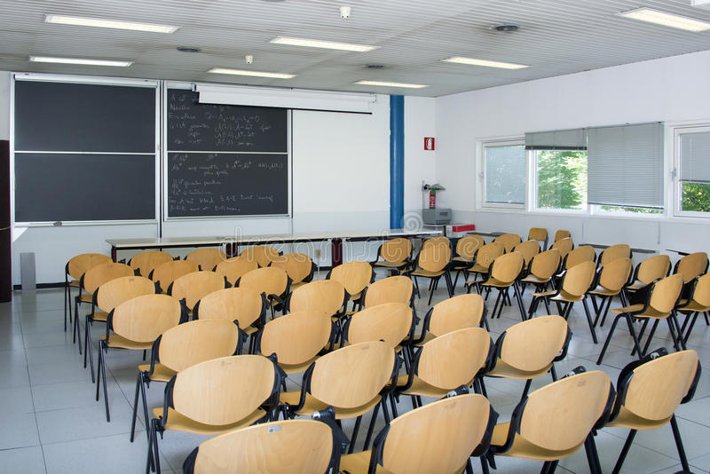 Empty classroom. An empty classroom with wooden chairs royalty free stock photos