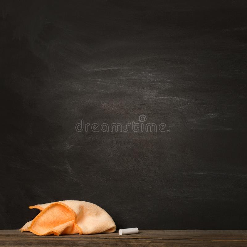 Empty clean black chalk Board. chalk and rag lie against. concept: back to school background stock images