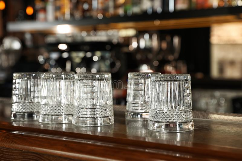 Empty clean glasses on counter royalty free stock images
