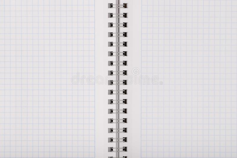Empty clean notebook in grid sheet. Empty clean notebook in grid sheet close up. Texture background royalty free stock images