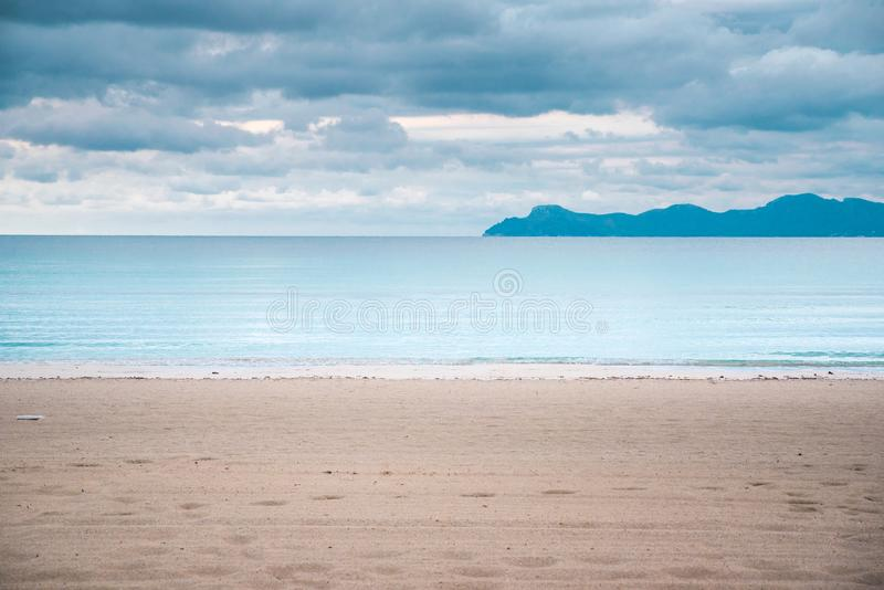 Empty clear beach in autumn morning. Depression, Sadness, Melancholy concept photo royalty free stock images