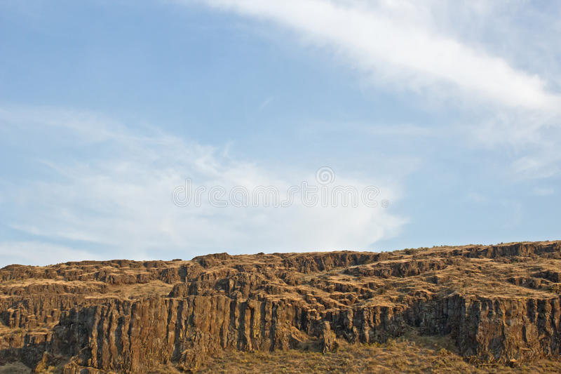 Download Empty Cliffs Under Blue Cloudy Skies Stock Photo - Image of photograph, cliffs: 26797924