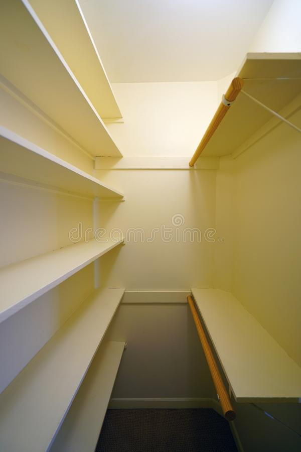 Empty clothes closet with shelves. Before a move in royalty free stock photos