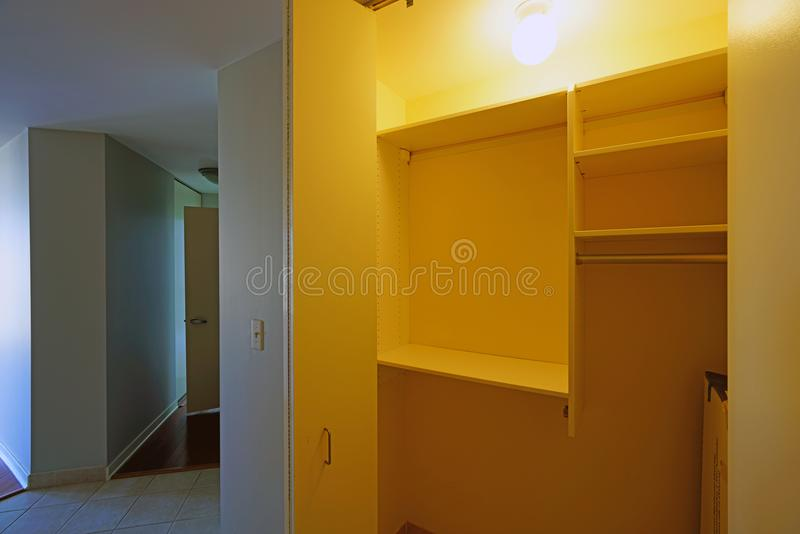 Empty clothes closet with shelves. Before a move in stock image