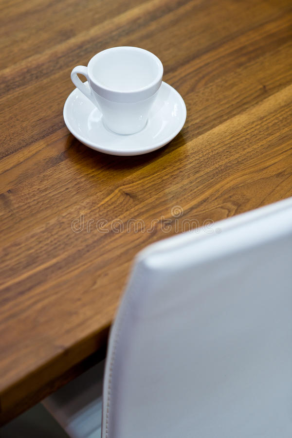 Empty coffee cup on wooden table stock photo