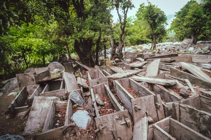 Empty coffins. Empty wooden coffins at the old forgotten graveyard in the Bamoret valley in northern Pakistan royalty free stock image