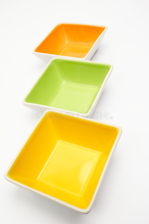 Empty Colorful Dishes On White Stock Photo