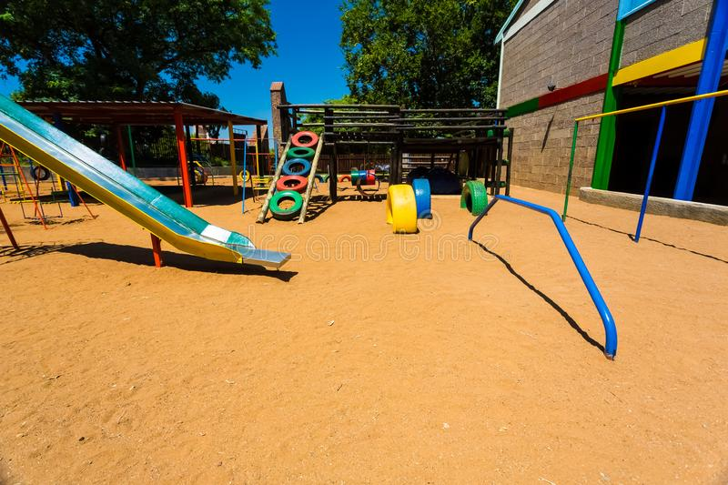 Empty Colorful Preschool Playground slide. Newcastle, South Africa - February 12 2015: Empty Colorful Preschool Playground royalty free stock photo