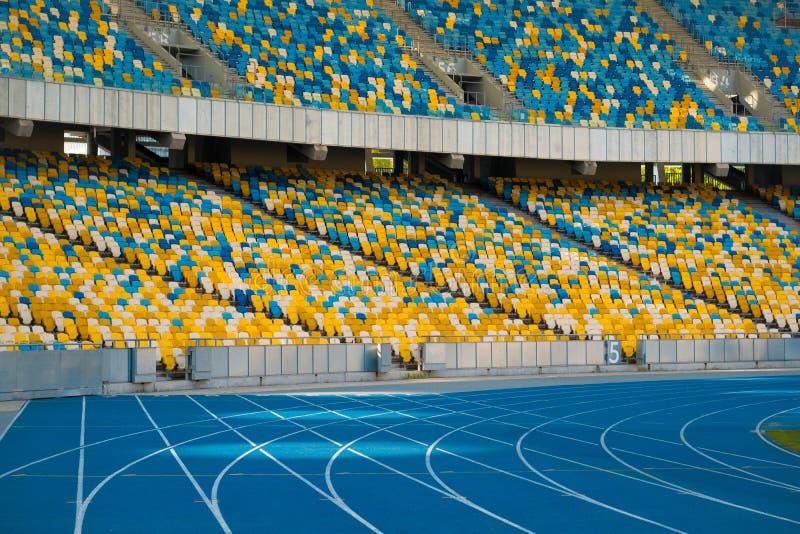 Empty colorful stadium seats and running tracks. stock image