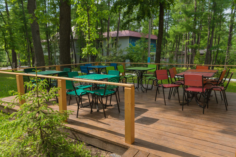 Empty colorful tables at an outdoor cafe royalty free stock photography
