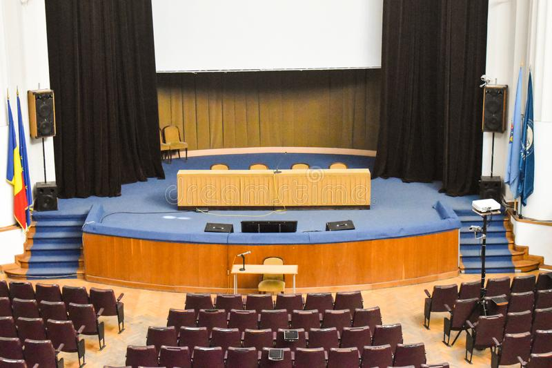 Empty conference hall prepared for summit guests with European Union and NATO flags. Spacious auditorium with rows of chairs,. Stairs and balconies - Bucharest stock images
