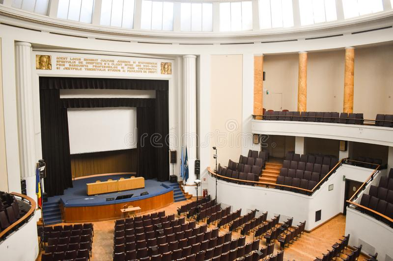 Empty conference hall prepared for summit guests with European Union and NATO flags. Spacious auditorium with rows of chairs, stock images