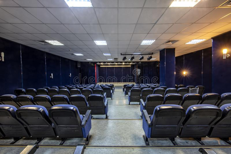 Empty conference,theater or cinema hall with rows of blue seats royalty free stock images